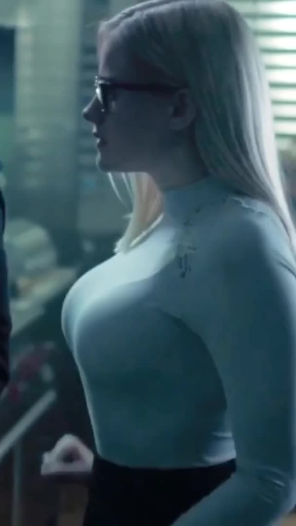 Olivia Taylor Dudley stretching a shirt to its limits