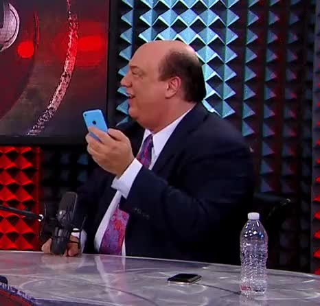 Watch and share A Gif Of Paul Heyman Laughing Hysterically At His Phone (reddit) GIFs on Gfycat