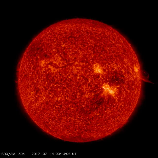 Watch and share M2.4 Solar Flare, July 14, 2017 - SDO AIA 304 GIFs by The Watchers on Gfycat