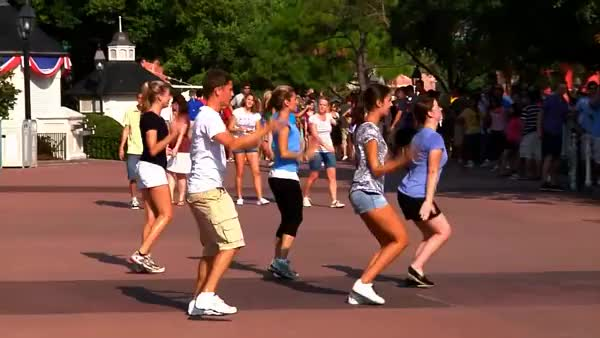 casual flash mob in Disney courtesy of PwC (reddit) GIF