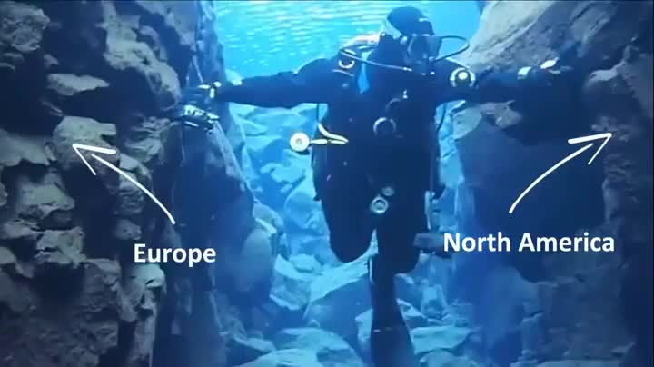 Scuba diver swimming between two continents GIFs