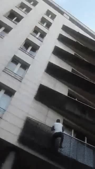 Watch and share Dude Climbs Four Floors Of An Apartment Building In Just Seconds To Rescue A Child GIFs by mossberg91 on Gfycat
