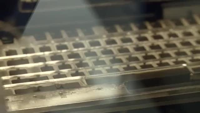 Watch and share Key Caps Being Engraved With A Laser At The Cherry Factory GIFs on Gfycat