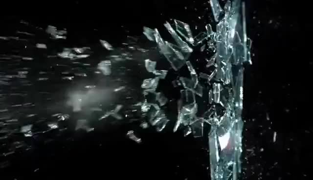Watch and share Shattering Glass Pane With Slingshot In Slow Motion Slow Mo HD Video Catapult Band And Glass Shards GIFs on Gfycat