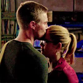 Watch and share Felicity Smoak GIFs and Forhead Kisses GIFs on Gfycat