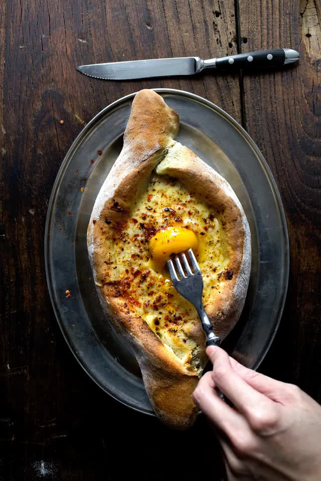 Watch and share GEORGIAN CHEESE AND EGG BREAD (ACHARULI KHACHAPURI) GIFs on Gfycat