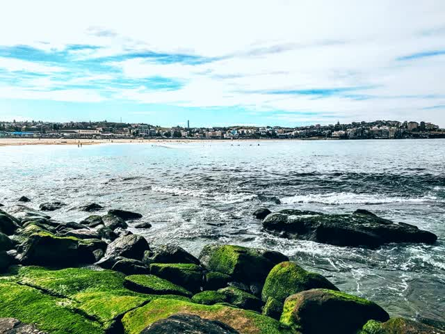 Watch and share Waves Crash Over Rocks At The Southern End Of Bondi Beach GIFs on Gfycat