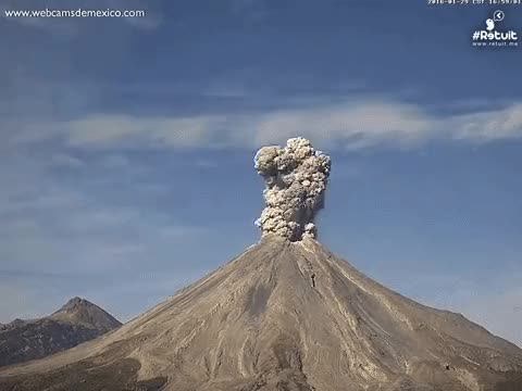 Watch and share Volcano Spurts Gigantic Ash Plume In Mesmerizing Time GIFs on Gfycat