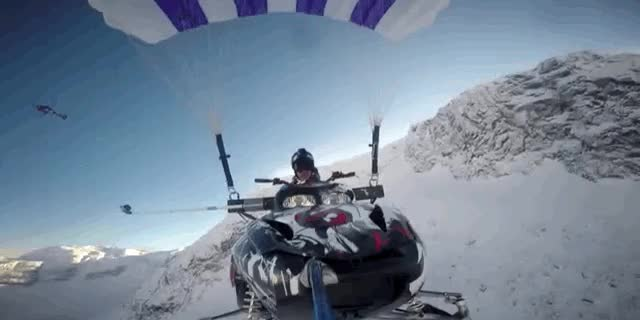 Watch and share Watch This Maniac Parachute His Snowmobile Off A Cliff GIFs on Gfycat
