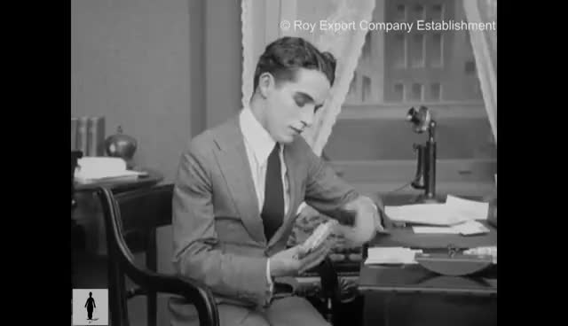 Watch and share Charlie Chaplin Reading Fan Mail - Rare Archival Footage GIFs on Gfycat