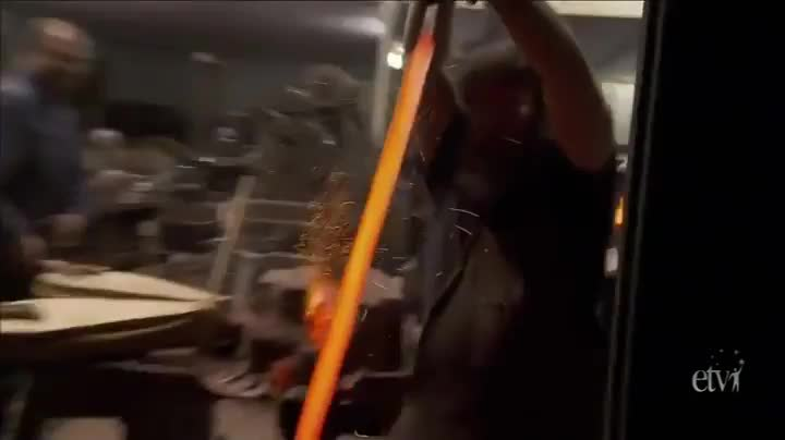 The quenching part of the sword making process looks badass GIFs