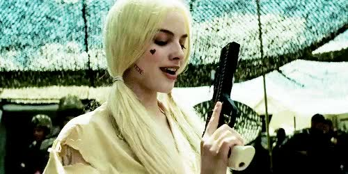 Watch and share Harley Quinn GIFs and Gun GIFs on Gfycat