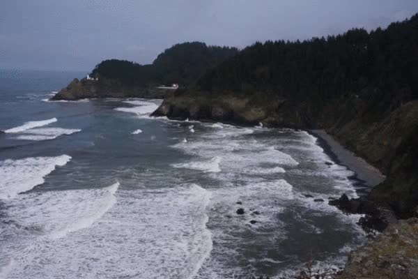 Watch and share Waves Along The Oregon Coast And Heceta Lighthouse In Background GIFs on Gfycat