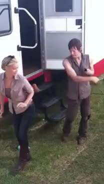 Norman whipping Laurie on set
