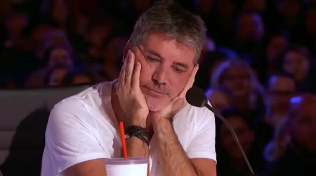 Simon is so bored talent take stop simon please omg oh my got god enough dying cowell can't boring bored awkward america's america agt GIF