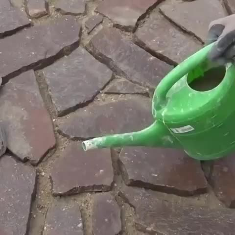 Filling in cracks with a watering can GIFs