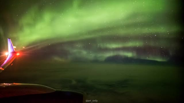Watch I had a whole row to myself on flight to Iceland, so I set up my tripod and camera and captured the Northern Lights at 35,000ft GIF by @aryeh95 on Gfycat. Discover more gifs GIFs on Gfycat