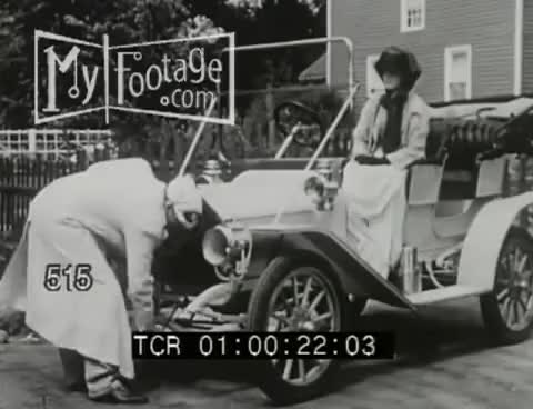 Watch and share Stock Footage - VINTAGE. HAND CRANK. FRUSTRATED DRIVER (1910s) / CARS GIFs on Gfycat