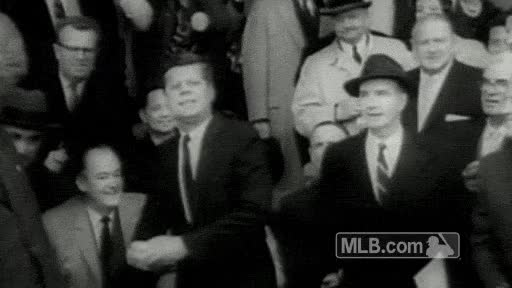 JFK demonstrates that, back in the day, first pitches were thrown...from the stands?