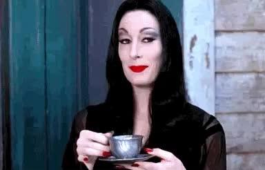 anjelica huston, coffee, cu, drink, flirt, gorgrous, hello, hey, hi, look, see, there, you, zip, Flirty look GIFs