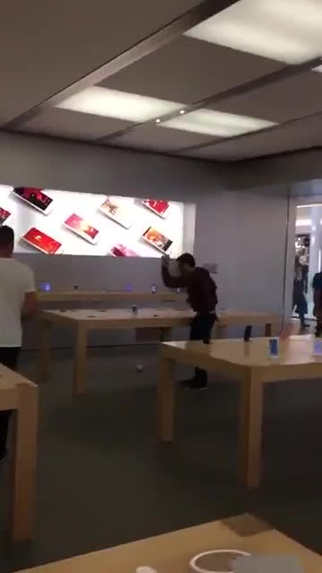 gifs, showerthoughts, Man smashes every iPhone in sight at Apple Store in France GIFs