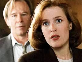 Watch and share Gillian Anderson GIFs and Mulder X Scully GIFs on Gfycat