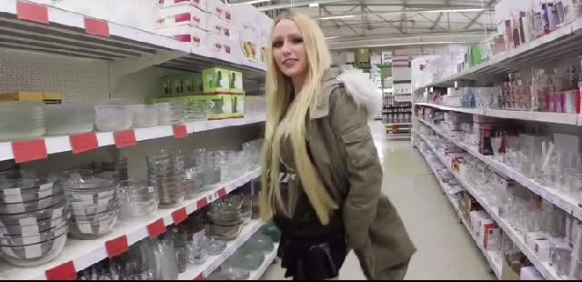 trashy beauty makes water into a glass in a store and places it back on the shelf