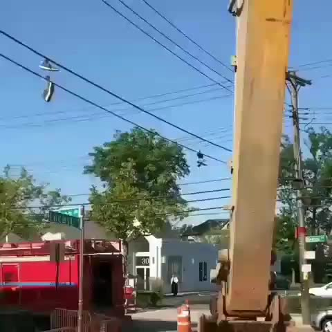 Watch and share Getting Shoes From Electrical Wire With A Excavator GIFs by Boojibs on Gfycat