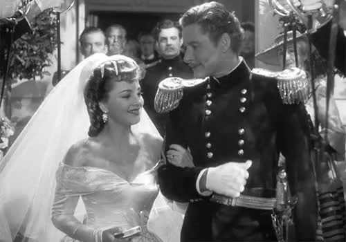"""Olivia De Havilland And Errol Flynn In """"They Died With Their GIF ..."""