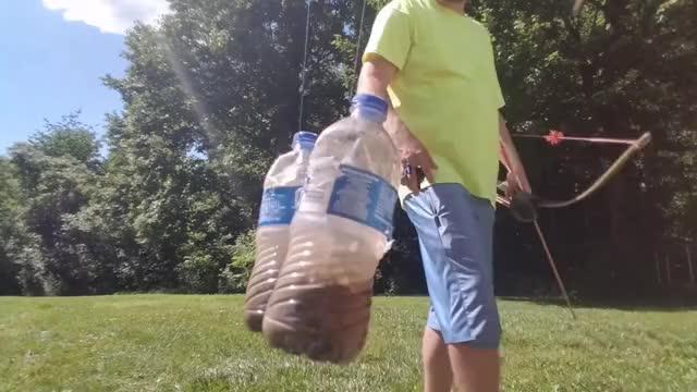 Watch and share Instinctive Archery Trick Shot- Double Swinging Bottles GIFs by meskal on Gfycat