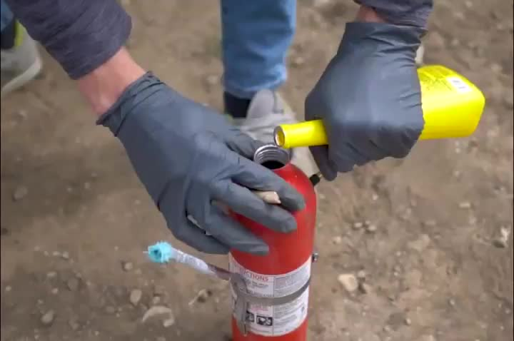 Guy modified fire extinguishers to become multicolored flame throwers (Video by The King of Random on Youtube) GIFs