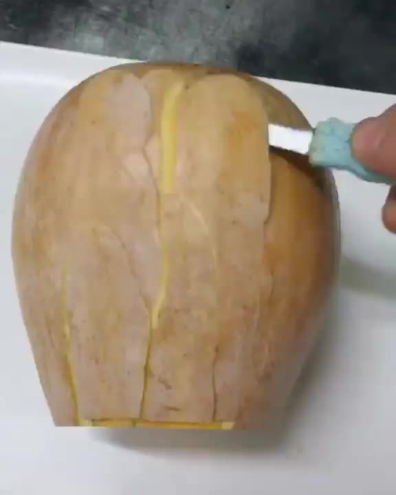 Watch and share Chef Carving An Intricate Fish Out Of Fruit GIFs by tothetenthpower on Gfycat
