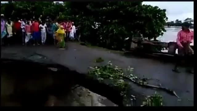Bridge collapses during a flood in India