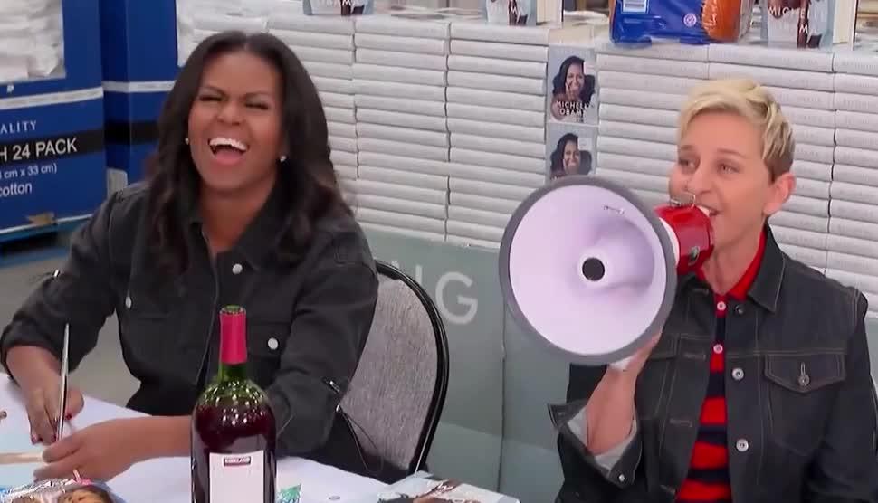 becoming, book, costco, demonstrate, ellen, ellen degeneres, funny, go, haha, hehe, hilarious, it, joke, lol, michelle, obama, sign, stop, to, wine, Ellen & Michelle Obama Go to Costco GIFs
