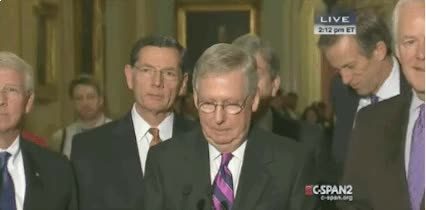 Watch and share Mitch McConnell Smiles Awkwardly animated stickers on Gfycat