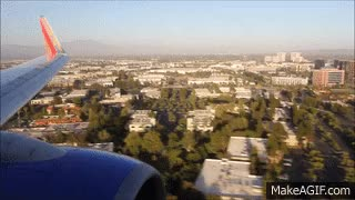 Watch and share Southwest Airlines Flight WN 2059 Sunset Landing In Orange County SNA (N284WN) GIFs on Gfycat