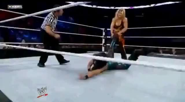 Beth Phoenix Hits Melina with her own Leg