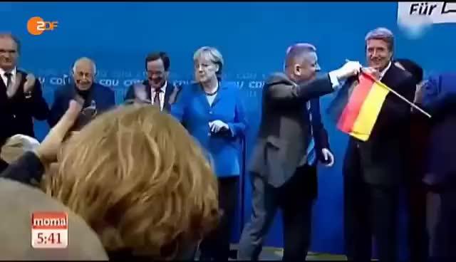 Watch and share Merkel Wirft BRD Fahne Weg GIFs on Gfycat
