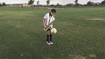 Watch and share 11-year-old-playing-Saxophone-while-juggling-a-soccer-ball GIFs on Gfycat