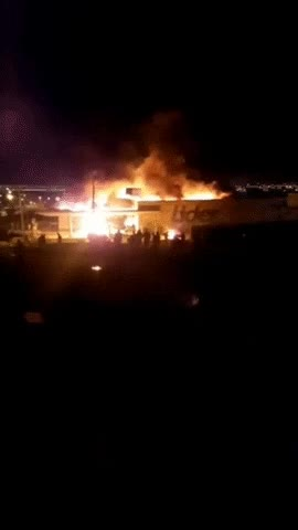 Watch and share Riots Right Now In Chile. A Supermarket From Walmart Chile Completely Burnt. GIFs on Gfycat