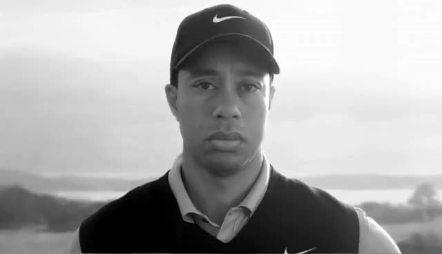 Watch and share Tiger Woods Awkward Stare GIFs on Gfycat
