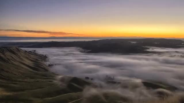Watch Sunrise over a foggy valley, New Zealand (reddit) GIF by @joffas11 on Gfycat. Discover more EarthPornGifs, earthporngifs GIFs on Gfycat