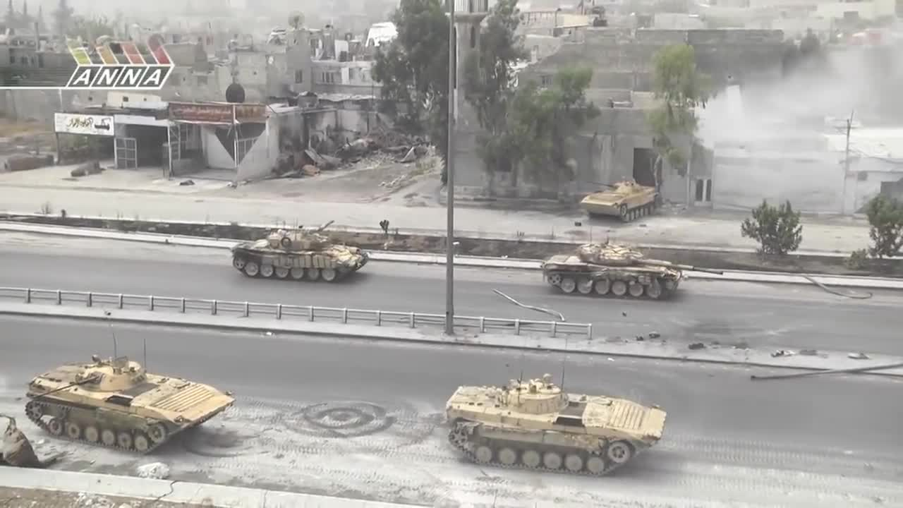 Syrian Taxi gets caught in the middle of a Syrian Army column GIFs