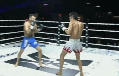 Angel Huerta Oblique Kicks Miguel Torres in the Knee Legacy Kickboxing GIFs