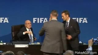 Watch Moment Sepp Blatter was showered with fake dollar bills - BBC News GIF on Gfycat. Discover more related GIFs on Gfycat