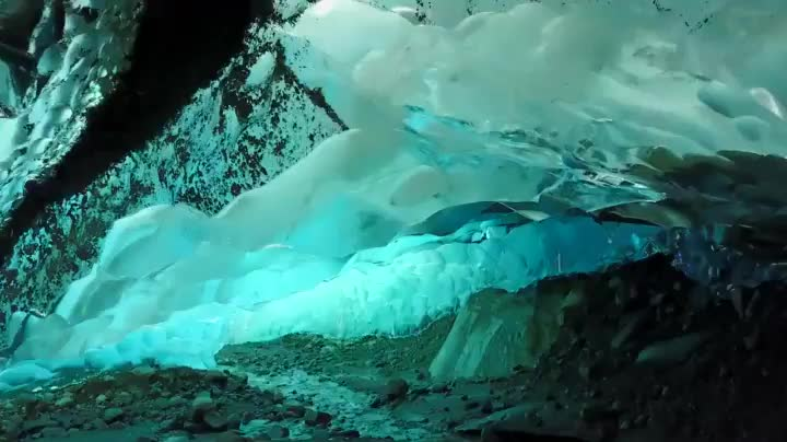 A drone being flown through an ice cave in Alaska GIFs