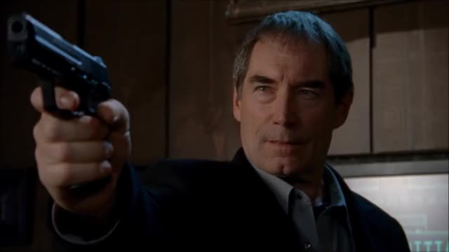 Watch and share Timothy Dalton GIFs and Gun GIFs by winstonchurchillin on Gfycat