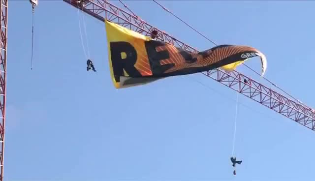 Watch and share Protesters Climb D.C. Crane, Release 'RESIST' Banner GIFs on Gfycat