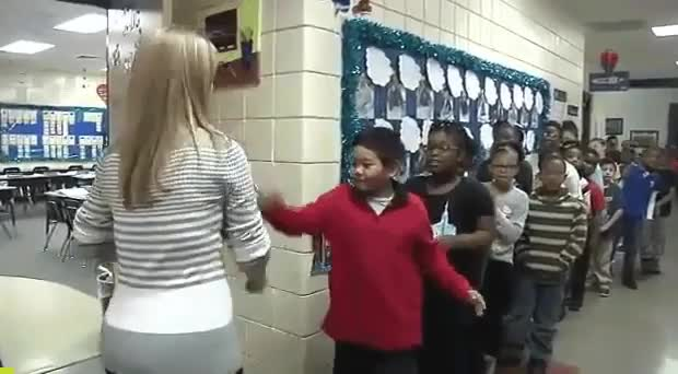 Teacher has a personalized handshake for each of her students gif