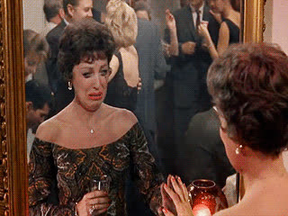 breakfast at tiffanys, crying, crying in the club, dramatic, mascara running, over the top, party, sad drunk, Lady Crying in Front of Mirror - Breakfast At Tiffany's GIFs